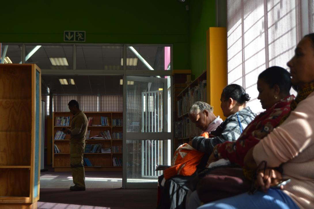 People wait to be assisted at the free legal clinic in a Cape Town Township